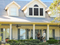 The front of this home just got 4 solar screens.