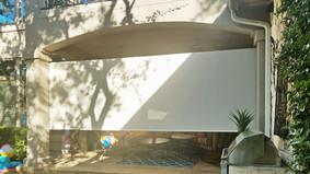 Beige fabric color outdoor blinds for porch Cedar Park Texas.