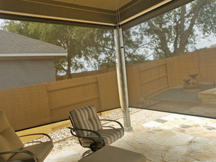 Pflugerville TX exterior patio shades made with brown fabric.
