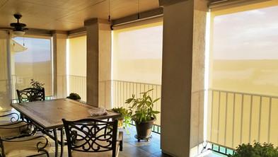 Austin TX patio sun screens used my beige white fabric.