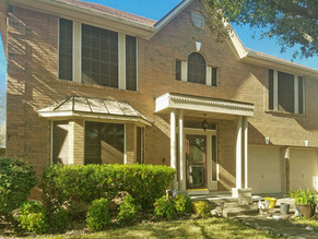 Mocha 80% fabric tan frame solar screens looks great on the front of this South Austin home.
