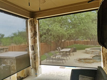 Pflugerville Texas outdoor shades for porch brown sun control fabric.