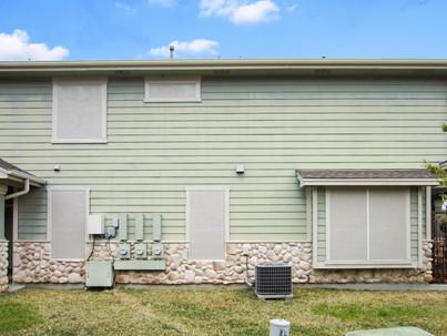 Stucco Solar Screens w/ light green exterior.  Hutto TX home.