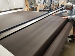 Cutting roll shade fabric at my shop in Austin.