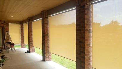 Beige fabric exterior sun shades Cedar Park Tx.