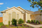 Huttto Texas home wearing my beige fabric solar screens. 2010 install.