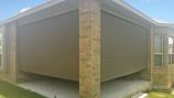 Austin Texas outdoor roller blinds brown fabric.
