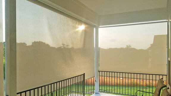 Outdoor roll up blinds  Leander TX grey white solar shade fabric.