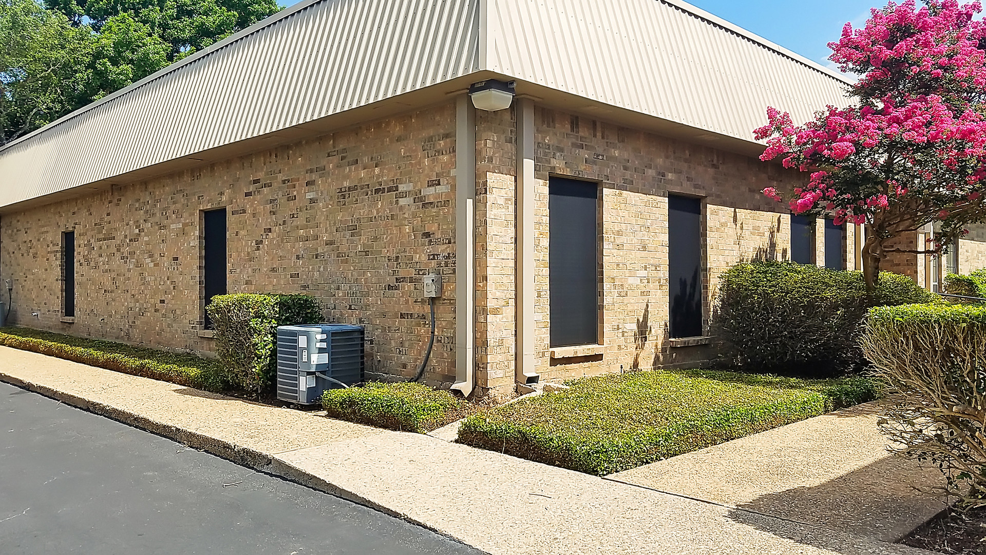 Austin TX solar screens for business office park windows.