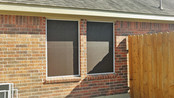 Choc 90% solar shade fabric White frame screens.  Solar shade for the windows.