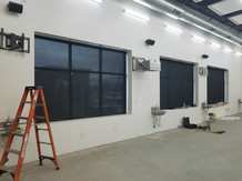 Large wide commercial window shades.