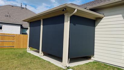 Black fabric 97% exterior solar shades Pflugerville Texas.