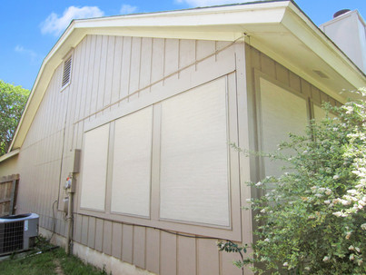 Stucco Solar Screens central Austin home.  Sun shaded windows.