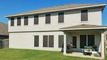 Choc 90% shade White framed solar screens Manor Texas.