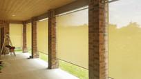 Cedar Park Texas roll up patio shades Beige fabric color.