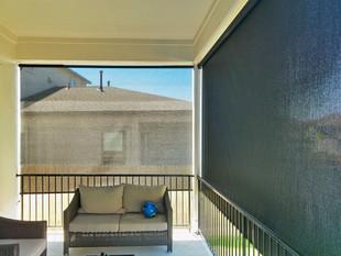Black sun control fabric screen porch blinds Austin Texas.