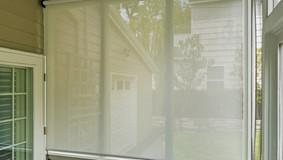 Leander Texas exterior solar shades used grey white solar fabric.