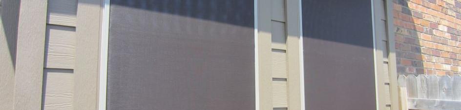 Solar screens installed on Ply Gem vinyl windows.