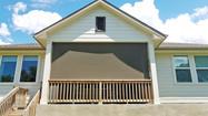 Roll down patio shades  Austin TX brown solar fabric.