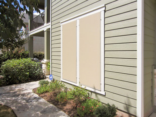This Austin Texas home got beige solar screens with tan framing.
