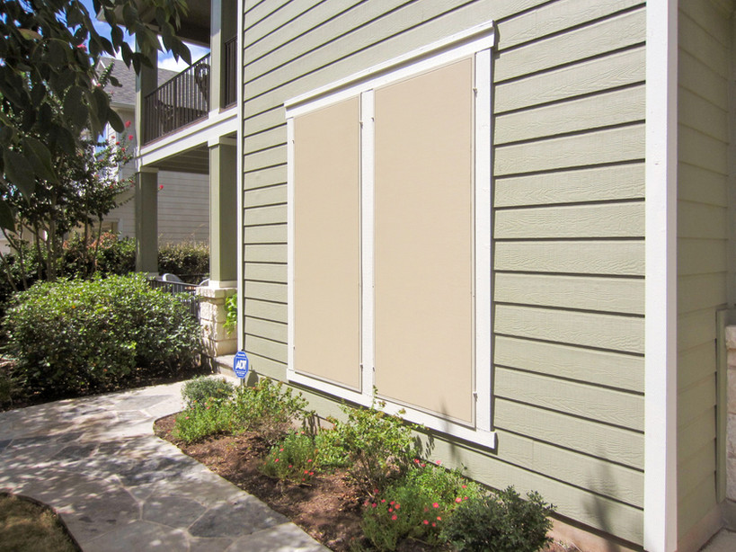 This Austin Texas home got beige solar screens with tan framing.