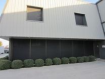 Commercial solar window screens.