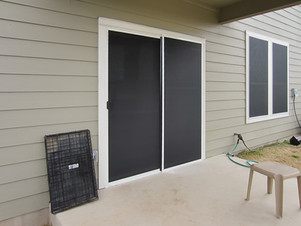 Solar screens are the best window covering for a sliding door.