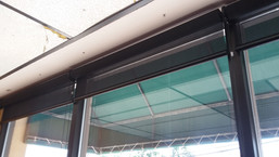 One commercial rollup shade per window panel.