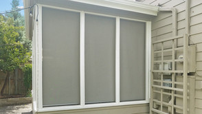 Grey White sun screens for porches & patios Central Austin 2020 install.