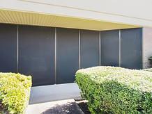 Exterior/Outdoor solar shade for commercial windows.