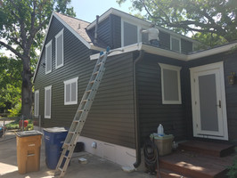 Central Austin TX home now wearing my grey fabric solar window screens.