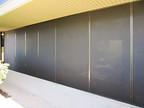 Office building exterior solar screens Austin TX.