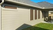 North Austin home is wearing my Mocha 90% fabric Tan framed solar screens.