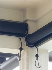 Pflugerville exterior solar shades with clutches staggered. One over the other.