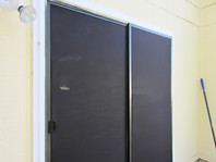 Solar screens are the #1 way to keep the sun off a sliding door.