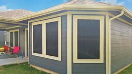 Sun protection screens Black 90% fabric Tan solar screen frame.