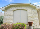 Stucco fabric solar screens on home in Round Rock TX.