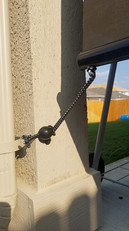 Sun shades for patio hooks installed into stucco.