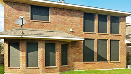 Solar window screens w/ Black 90% sun control fabric and Champagne color framing.