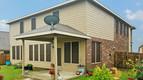 Buda Texas home now has sun shaded windows w/ my Mocha 80% solar screens w/ Tan framing.