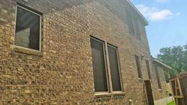 Choc solar window screens 80 shade Tan frame.