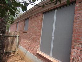 Grey colored solar screens look good against salmon colored bricks.
