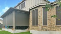 Brown sun shade fabric Georgetown Texas exterior blinds.