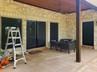 Double swing door is now shaded from the sun w/ solar screens.