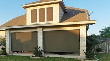 Brown solar fabric sun shades for decks Leander Texas.