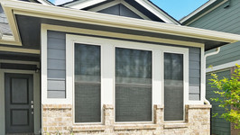 Black 80% solar screens for windows with Tan frame for Buda TX home.