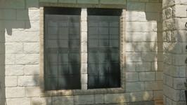 Black solar fabric 80% sun screens with Brown screen framing.