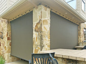 Brown solar fabric Austin roll up patio blinds.