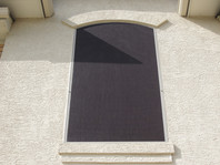 Full size arched solar screen fitted into upper and lower tracks.