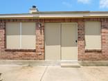Beige solar screens for windows and sliding door.